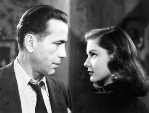 Humphrey Bogart as Marlowe, with Lauren Bacall as Vivian Rutledge in The Big Sleep